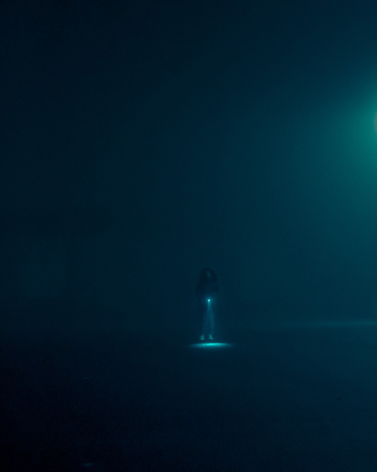Dystopian Images Explore a Foggy Irish Town Drenched in Aquamarine Light