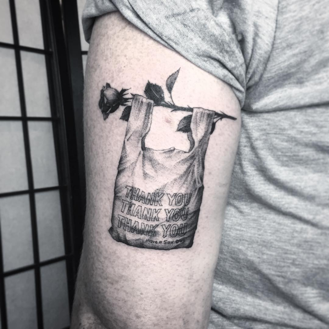 Delicate Flowers Juxtaposed with Modern Dystopian Imagery in Tattoos by Lena Lu