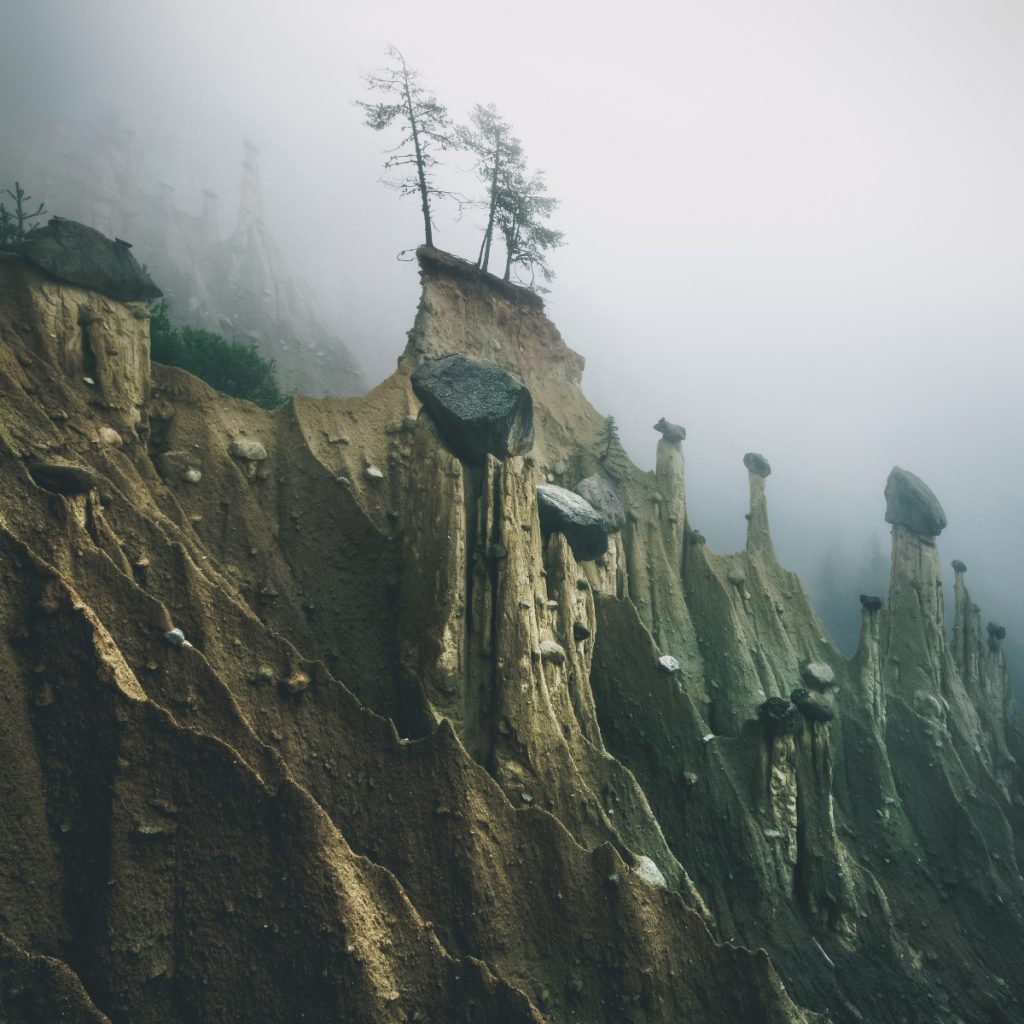 'Earth Pyramids' Captured in the Foggy Early Morning Light by Photographer Kilian Schönberger
