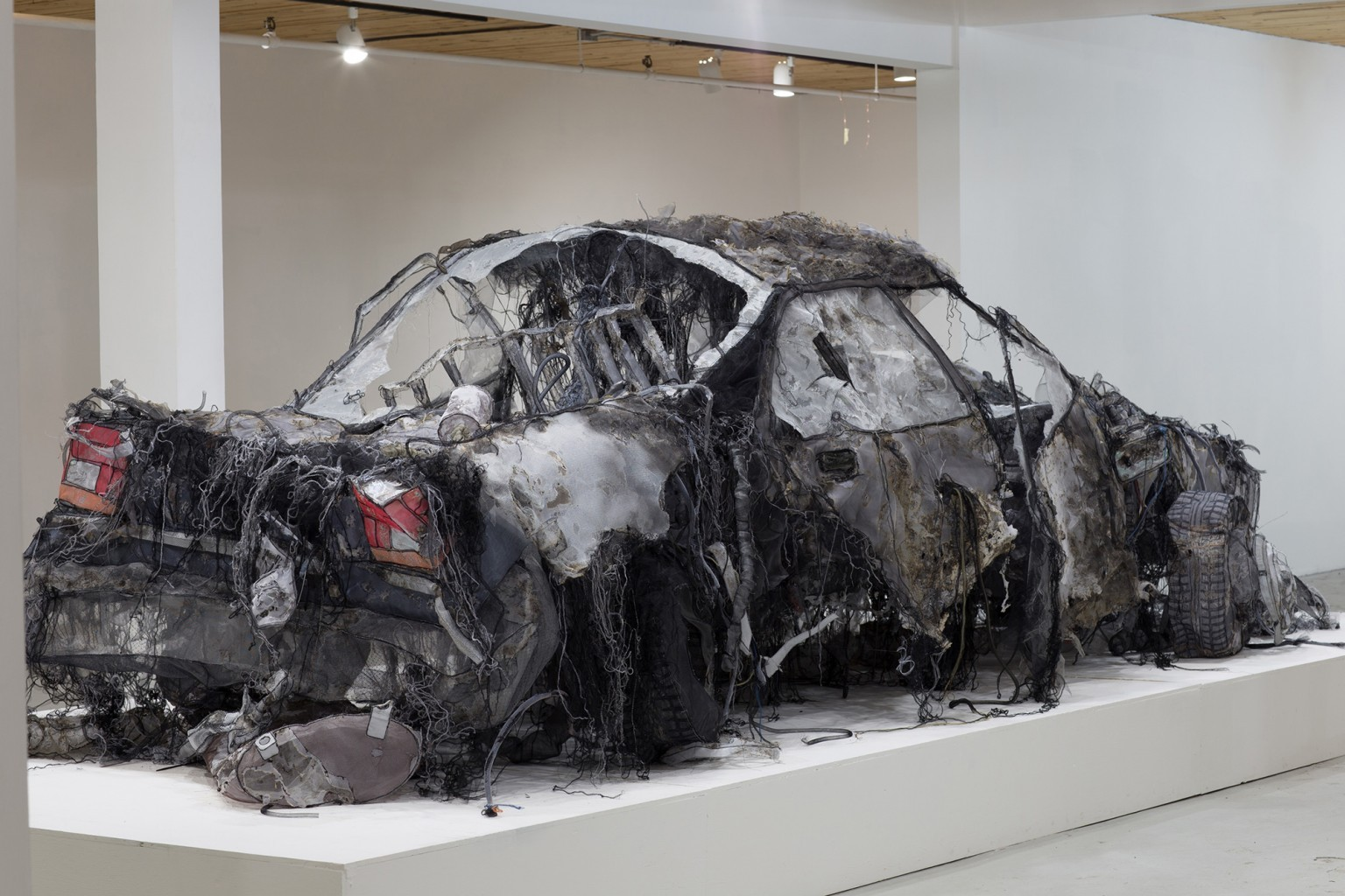 A Full-Scale Demolished Car Constructed From Silk, Aluminum Mesh, and Tulle by Jannick Deslauriers