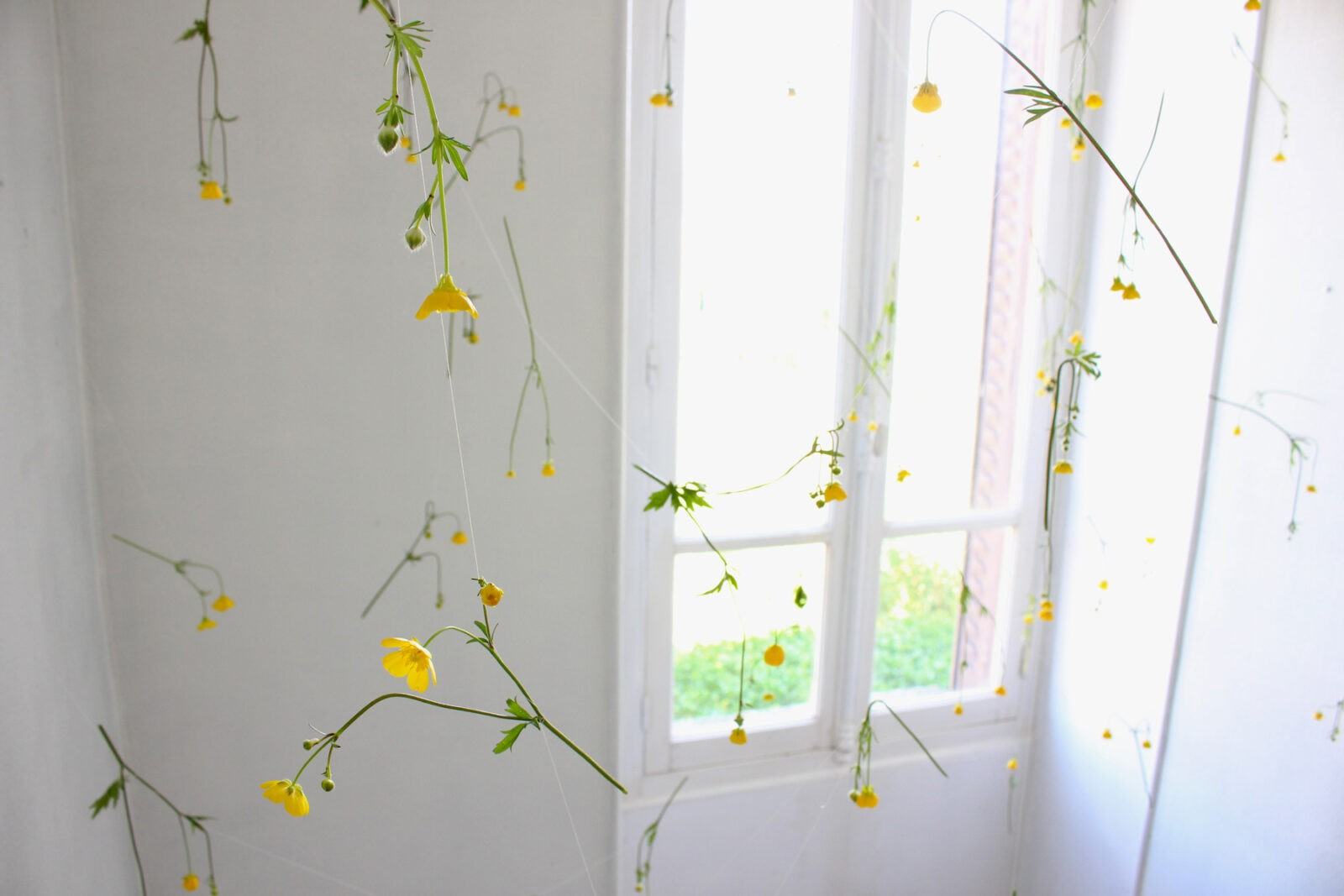 Delicate Accumulations of Colorful Spring Flowers Installed in a Historic French Home