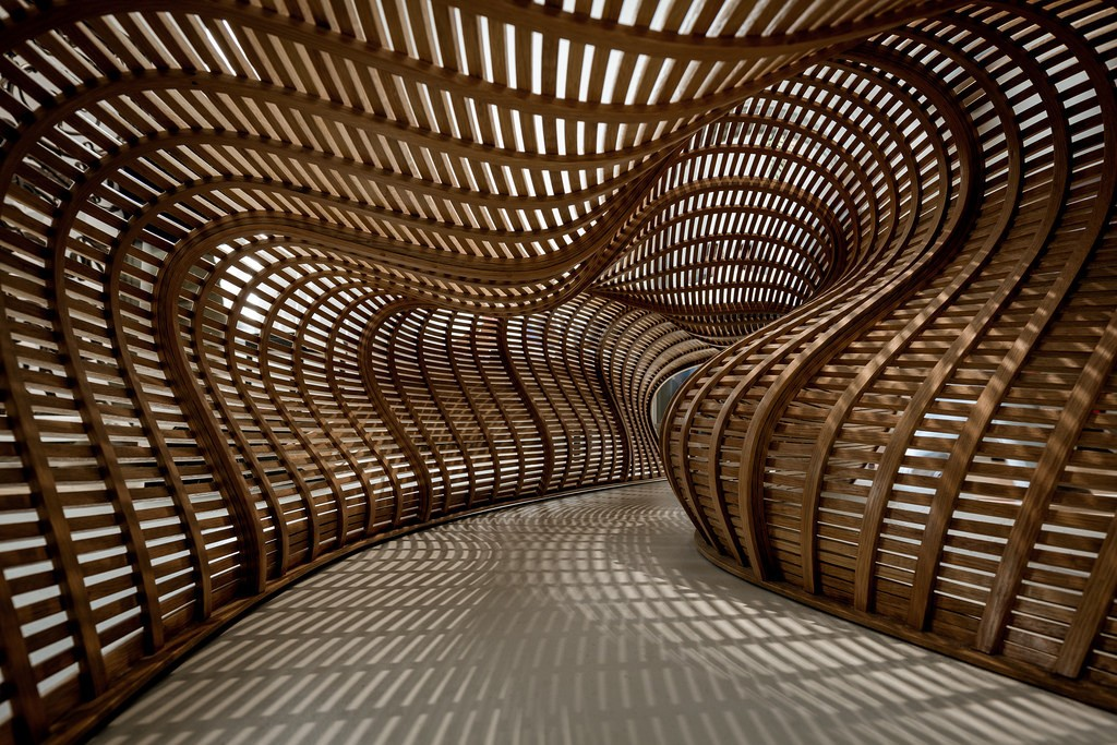 Sinuously Curved Benches Made with Thin Strips of Steam-Bent Hardwood