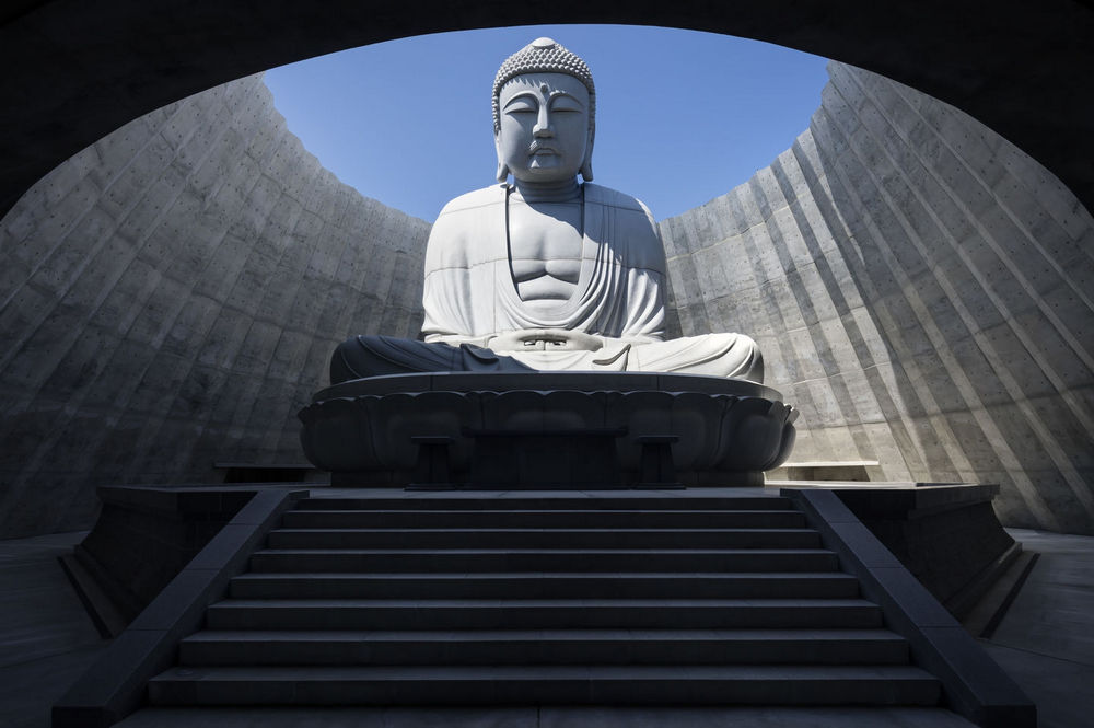 At the Top of the Mountain in Japan Towers a Gigantic Size Buddha