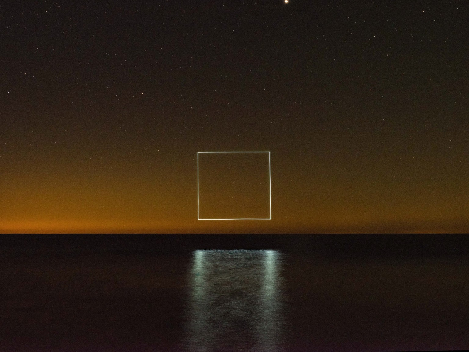 Illuminated Symbols Hover Above the Horizon in New Light Drawings by Reuben Wu