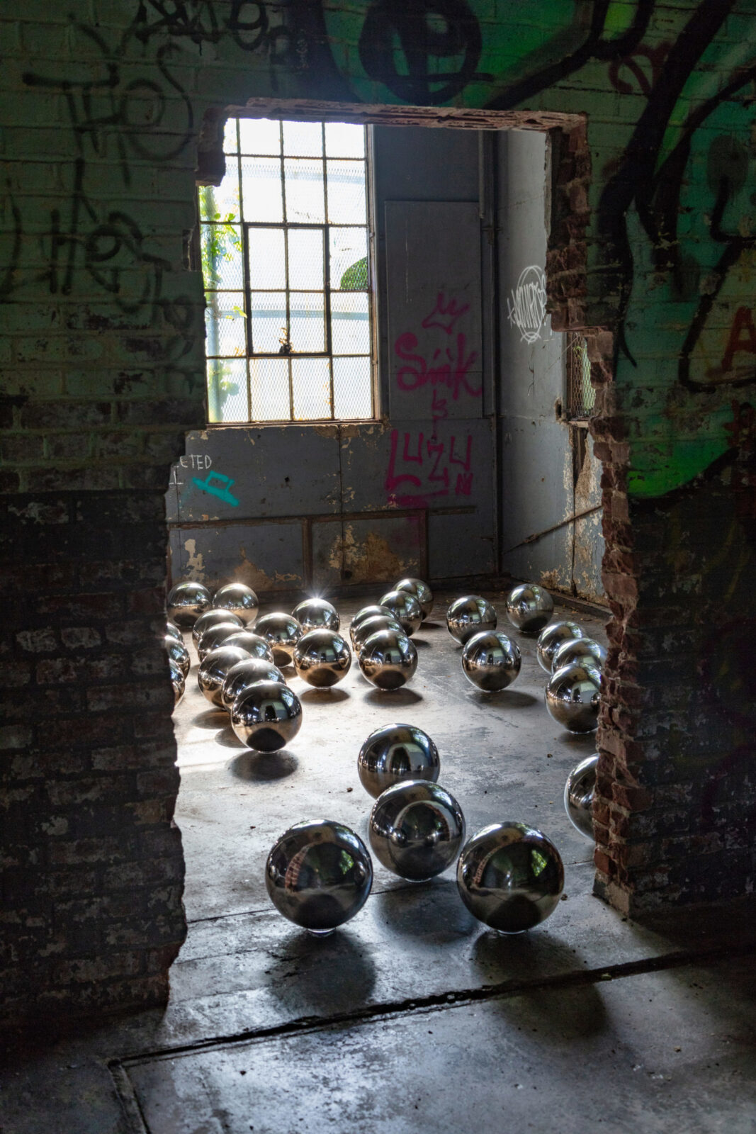 Take a Walk Through Yayoi Kusama's 'Narcissus Garden' Inside an Abandoned Factory in the Rockaways
